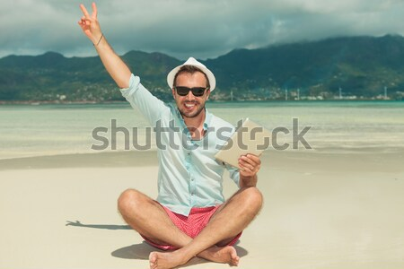 man  celebrating success on the beach Stock photo © feedough