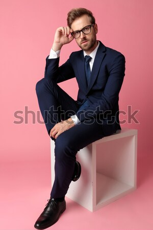 business man sitting on a table while scratching his head Stock photo © feedough