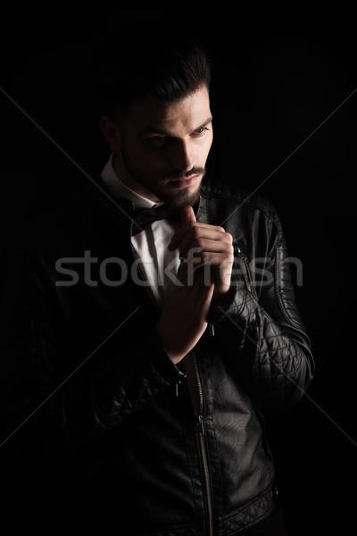 Uomo d'affari pollice mento attrattivo Foto d'archivio © feedough