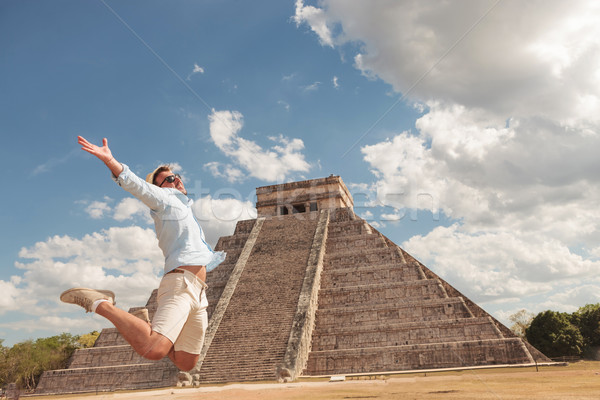 Happy young man jumping of happiness Stock photo © feedough