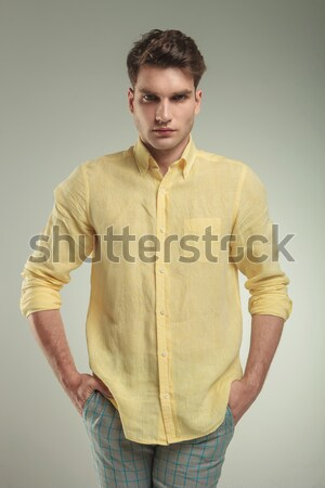 attractive young man in casual shirt with hands on waist Stock photo © feedough