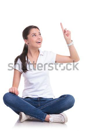 Sentado casual mujer victoria signo Foto stock © feedough
