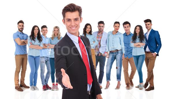 Fiatal üzletember csapat kézfogás lezser áll Stock fotó © feedough