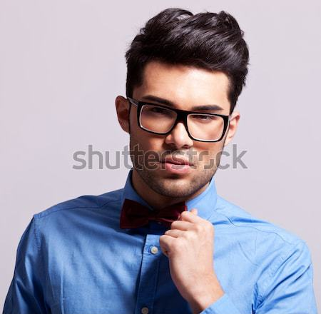 portrait of pensive young man wearing blue sunglasses and waistc Stock photo © feedough