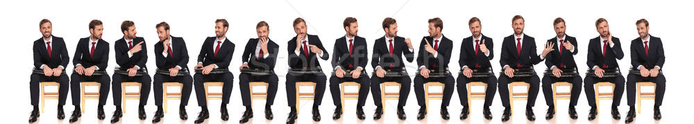 large group of the same businessman with different reactions  Stock photo © feedough