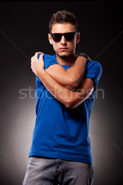 young casual man with palms on his shoulders Stock photo © feedough