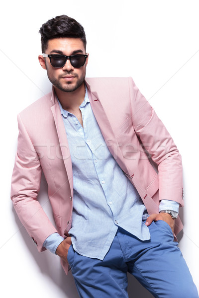 casual man with hands in pockets and raised lapels Stock photo © feedough