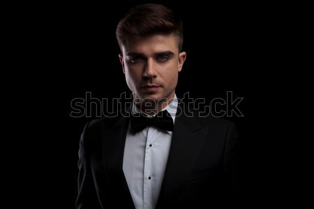 long haired young man in velvet suit and bow tie Stock photo © feedough