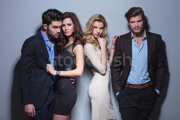 two women look at you beside their men Stock photo © feedough