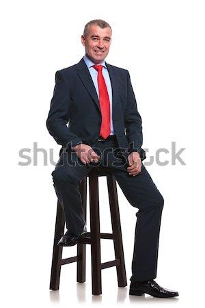 Uomo d'affari alto sgabello ritratto di mezza età seduta Foto d'archivio © feedough