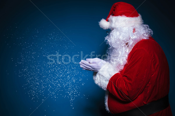 Side view of Santa Claus blowing snow Stock photo © feedough
