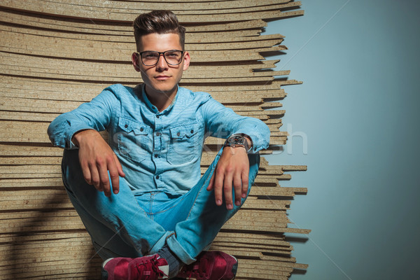 smart man sitting in studio with hands on knees  Stock photo © feedough