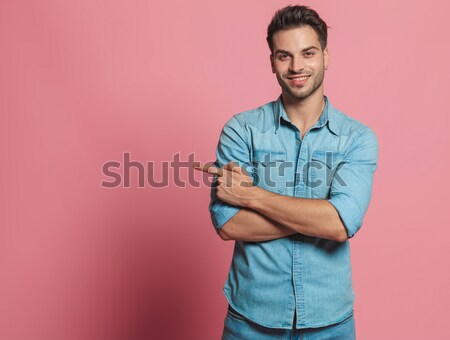 Jeune homme bleu polo posant mains portrait Photo stock © feedough