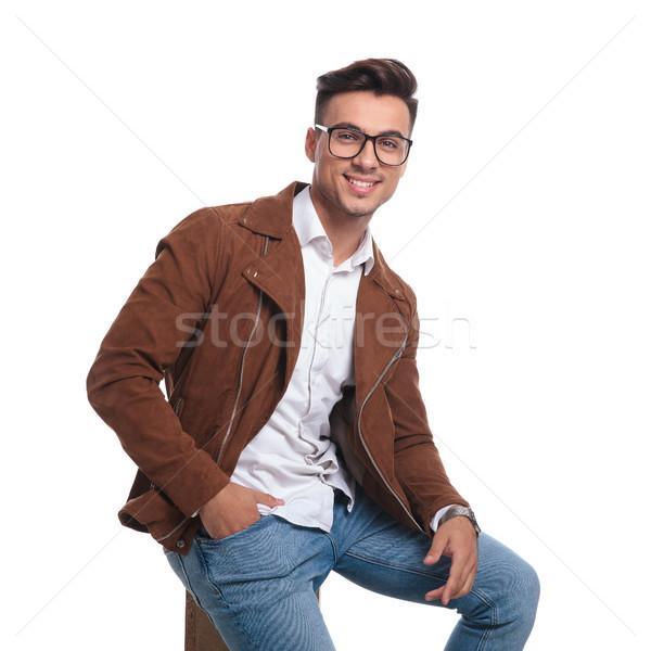 Sonriendo joven chaqueta de cuero gafas cuadro Foto stock © feedough