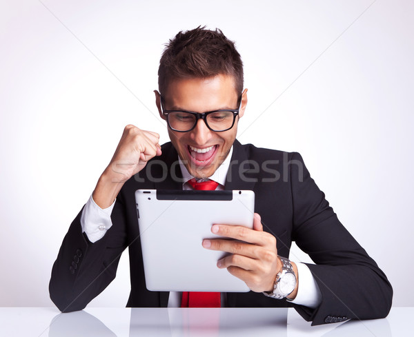 Stock photo: best news received by a business man on pad