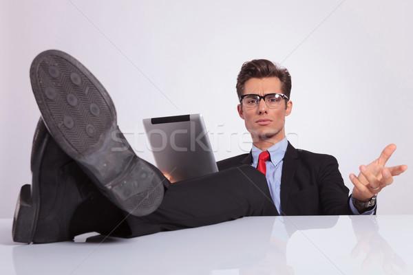 business man legs on desk holding tablet Stock photo © feedough