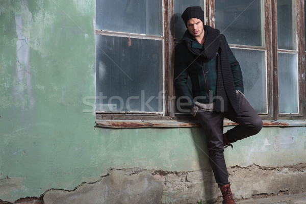 young fashion man leans on window sill Stock photo © feedough