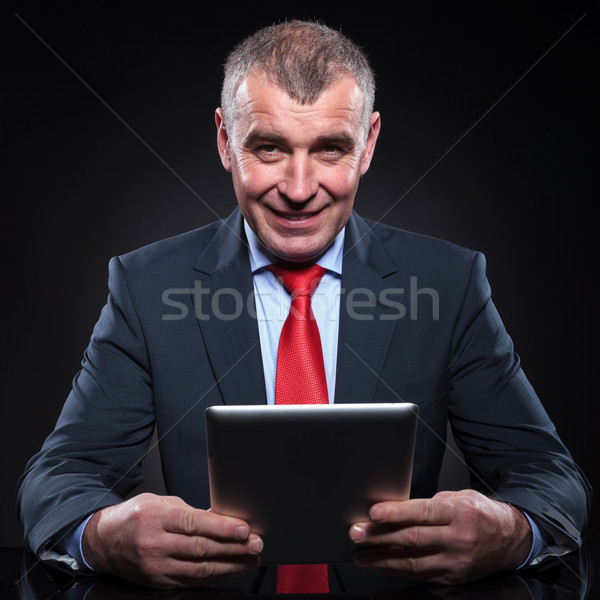 old business man working on his tablet pad computer Stock photo © feedough