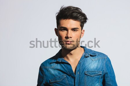 Man with his hand in pocket Stock photo © feedough