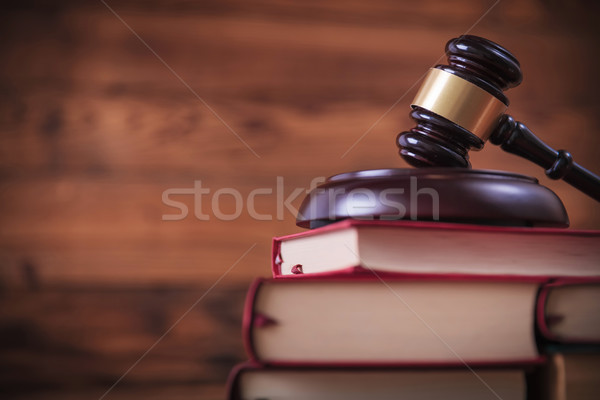 Stock photo: books with judge's hammer on top