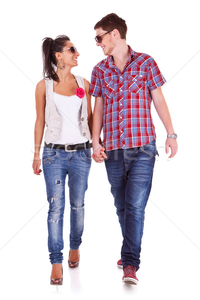Casual couple walking towards the camera Stock photo © feedough