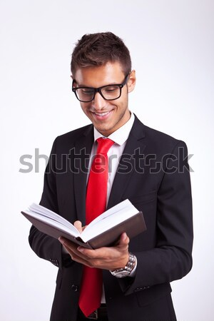 young man in a suit reading an interesting book Stock photo © feedough