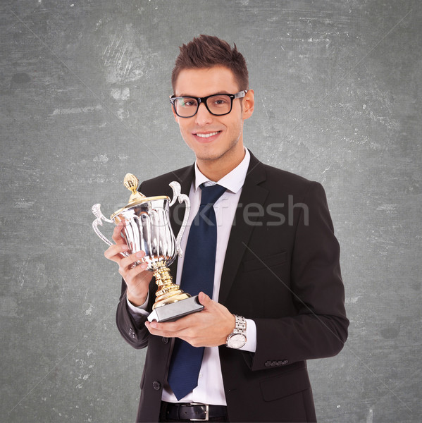 business man  with glasses holding a big trophy Stock photo © feedough