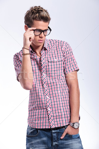 casual man adjusting specs Stock photo © feedough