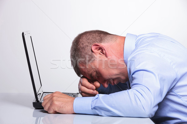 old business man sleeping on his laptop Stock photo © feedough