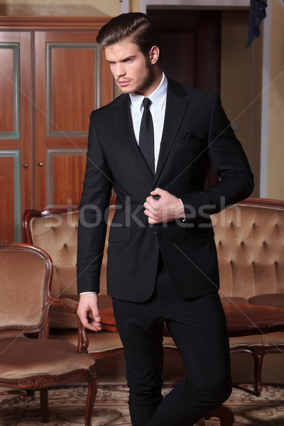 business man unbuttons suit looking away Stock photo © feedough