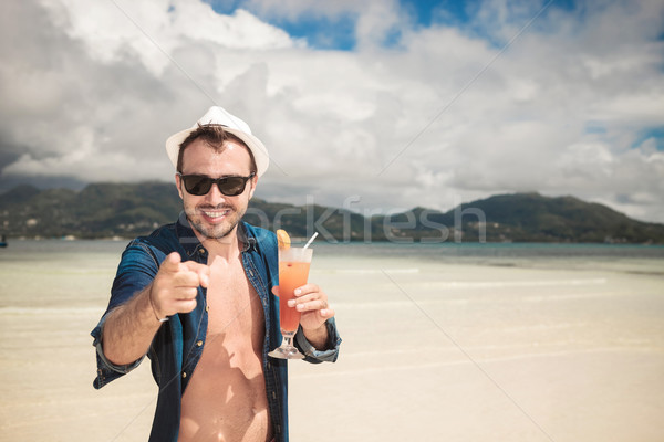 Attractive young happy man pointing at you  Stock photo © feedough