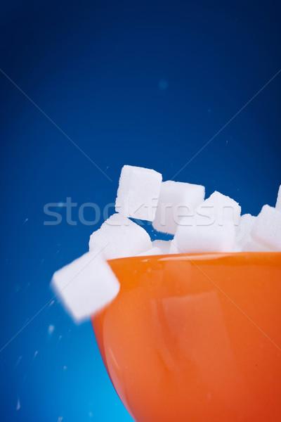 Macro detalle terrones de azúcar naranja tazón azul Foto stock © feedough