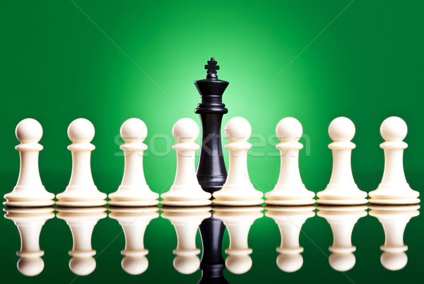 white pawns in front of a black king  Stock photo © feedough