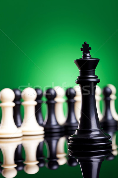 black king standing in front of all the pawns Stock photo © feedough