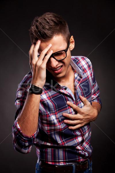 Jeune homme déception geste colère noir coeur Photo stock © feedough