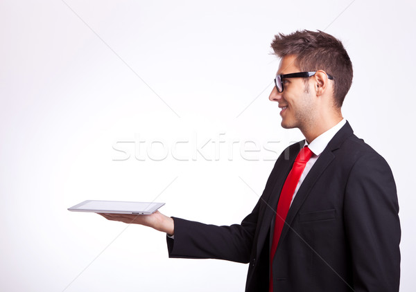 young business man holding a touch screen pad Stock photo © feedough