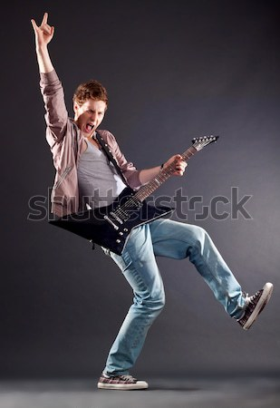 model rocking on an electric guitar Stock photo © feedough