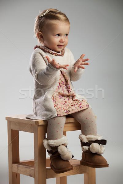 сидящий девочку рук вид сбоку серый Сток-фото © feedough