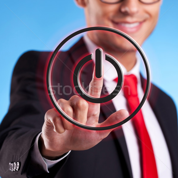 Stock photo: business man pressing ON OFF button