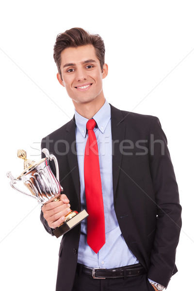 Stock photo: business man winner holding a cup trophy