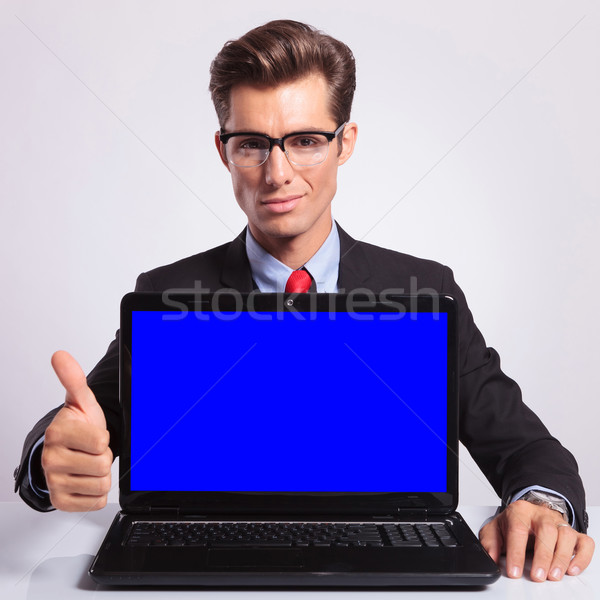 business man with laptop & thumb up Stock photo © feedough