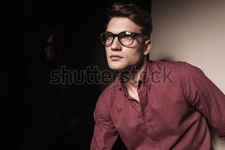 Stock photo: casual young business man looking up.