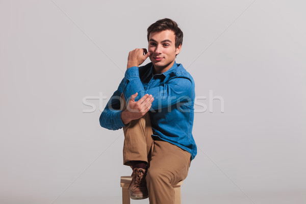 seated man holding his elbow and leg to chest Stock photo © feedough