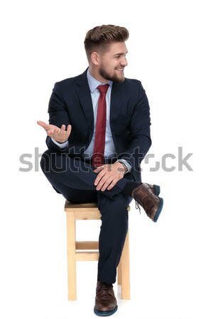 young un shaved business man is sitting on chair  Stock photo © feedough