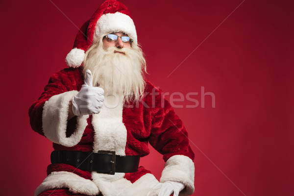 seated santa claus making the ok thumbs up sign  Stock photo © feedough