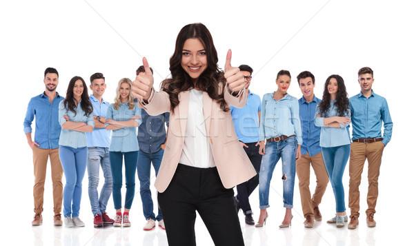 Femme d'affaires chef d'équipe signe permanent Photo stock © feedough