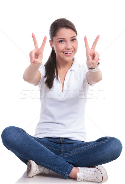 casual woman sits & victory Stock photo © feedough