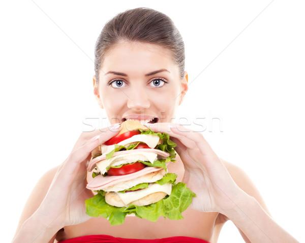 young woman eating a huge sandwich Stock photo © feedough