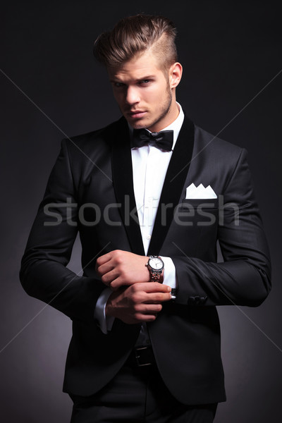 business man fixing cufflinks Stock photo © feedough