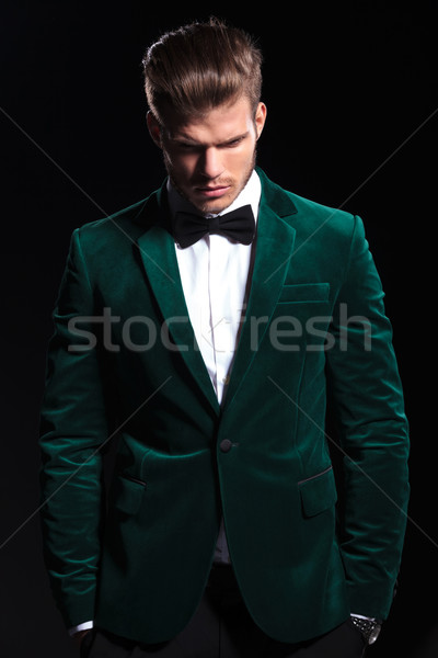 man in a green velvet suit is looking down Stock photo © feedough